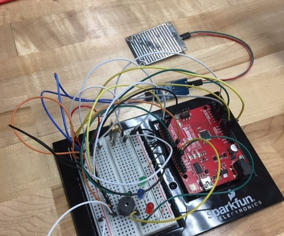 Using Temperature, Rainwater, and Vibration Sensors on an Arduino to Protect Railways