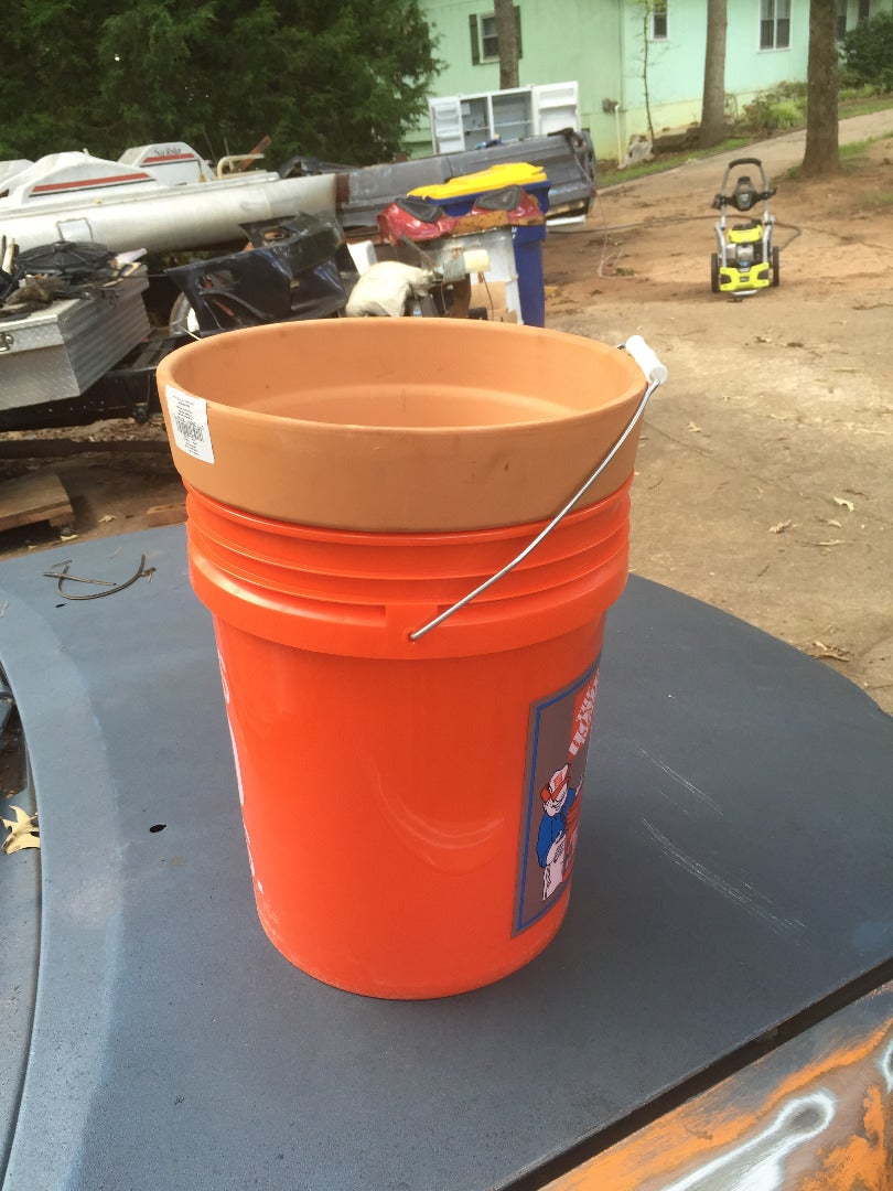 Place Your Smaller Clay Pot Into Your Larger Bucket