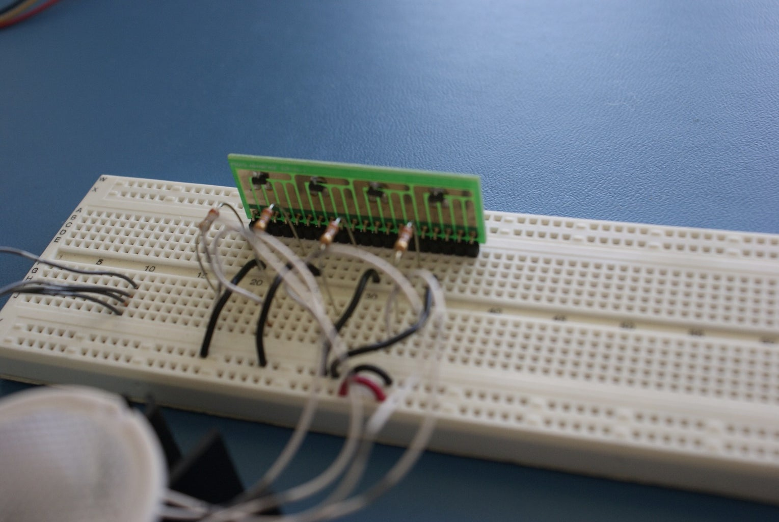 Connect the LED to the MOSFETs