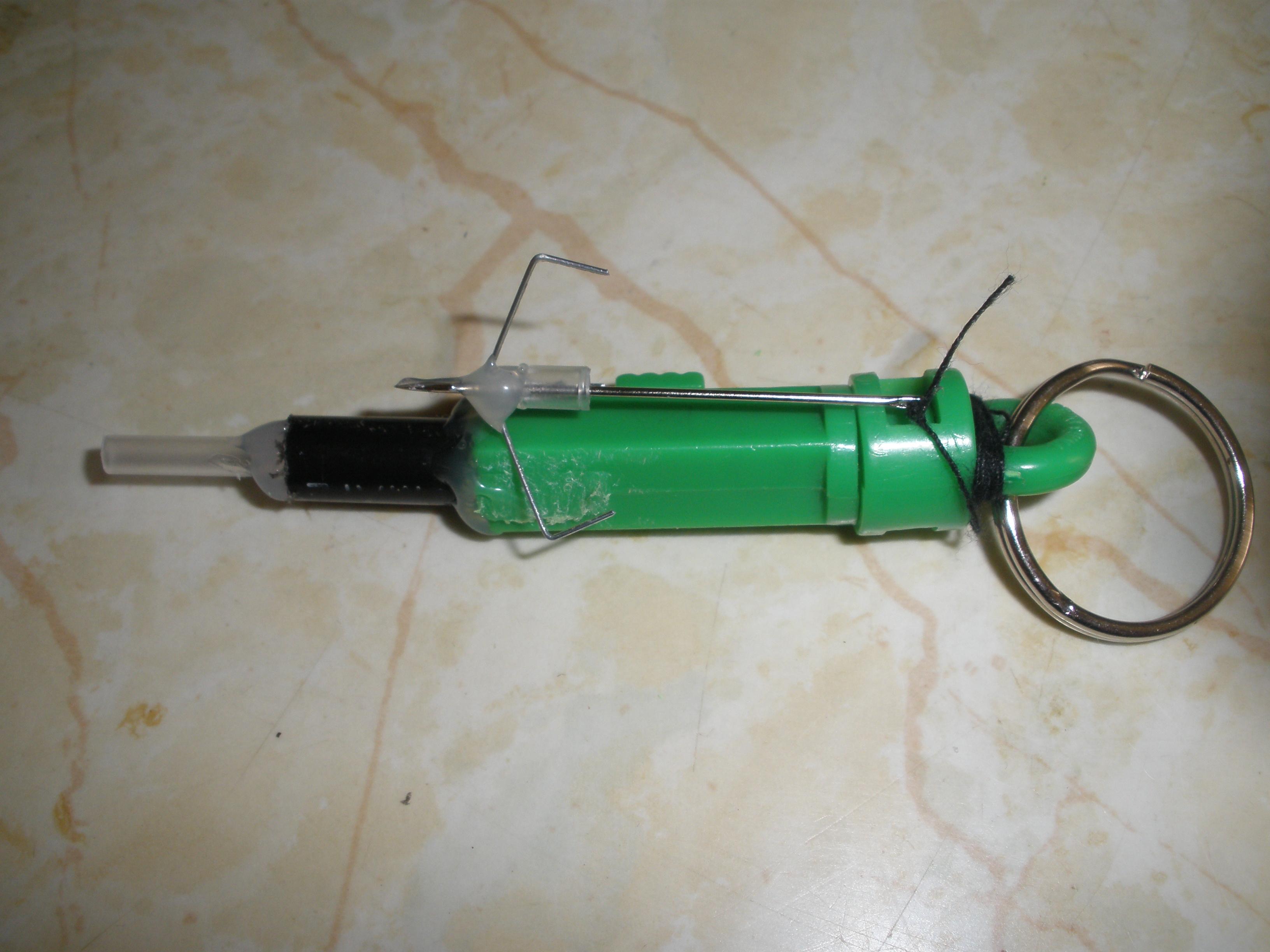 Pocket sized grapple gun
