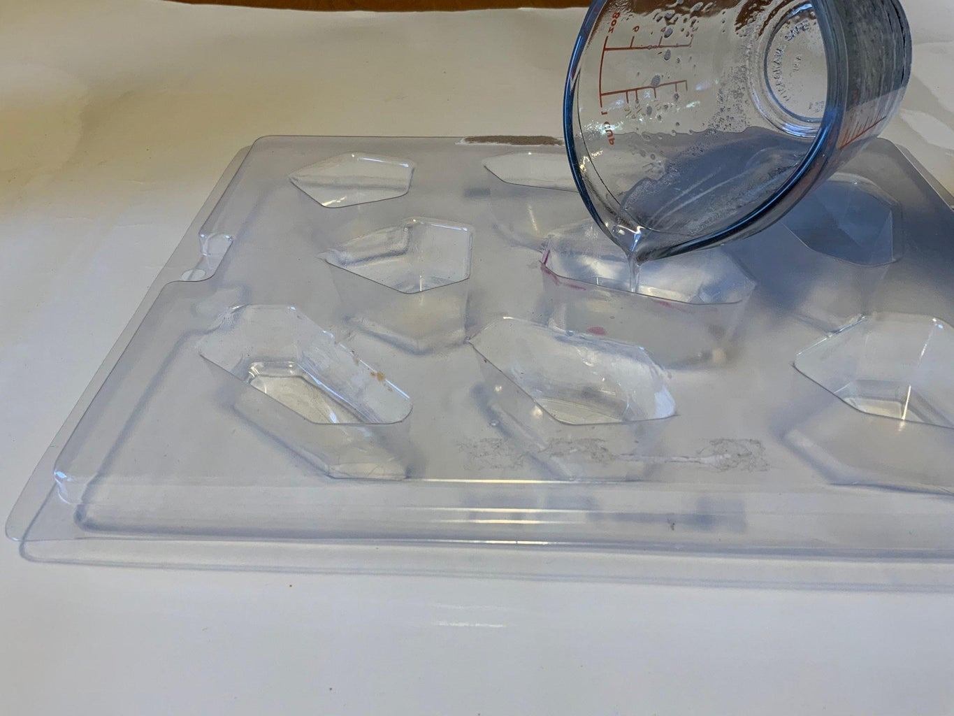 Pouring the Gelatin Into the Soap Molds