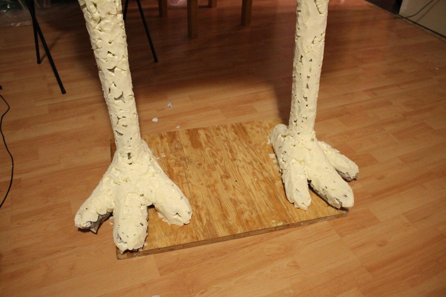 Spray Foam Shaping the Legs