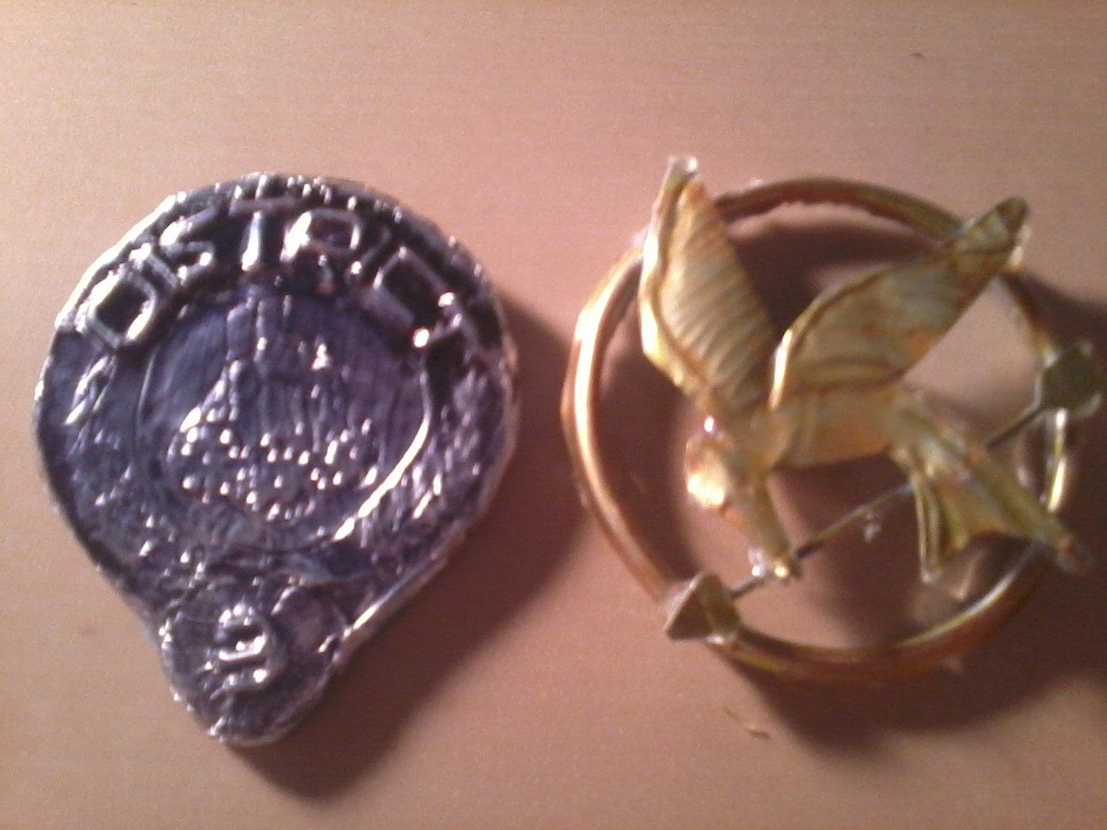 Hunger Games Mockingjay Pin and District Seal