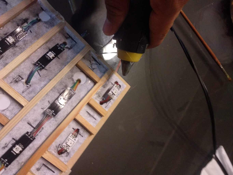 Hot Glue Gunning the LEDs
