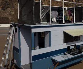 EASY 3-PERSON CAMPER WITH OUTDOOR KITCHEN & SHOWER, BATHROOM, AND SUNDECK