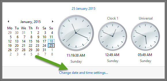 """Click on the Time Displayed on the Right End of the Taskbar and Then """"Change Date and Time Settings"""""""