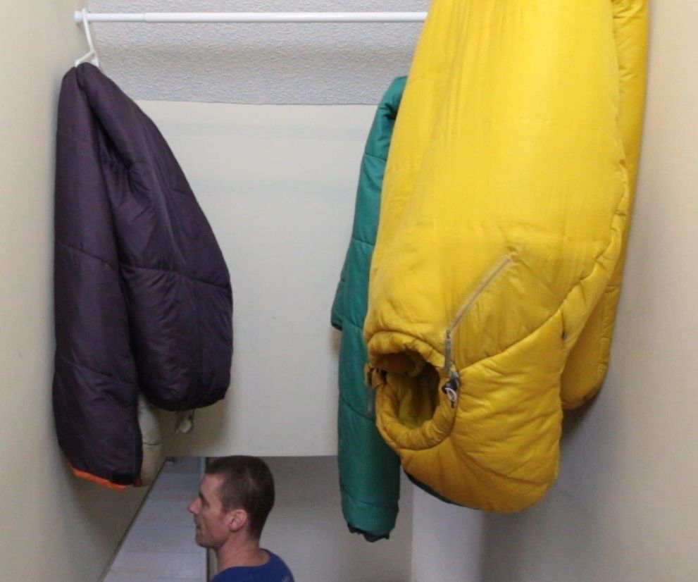 Stairway Overhead Shower Rod Sleeping Bag Storage