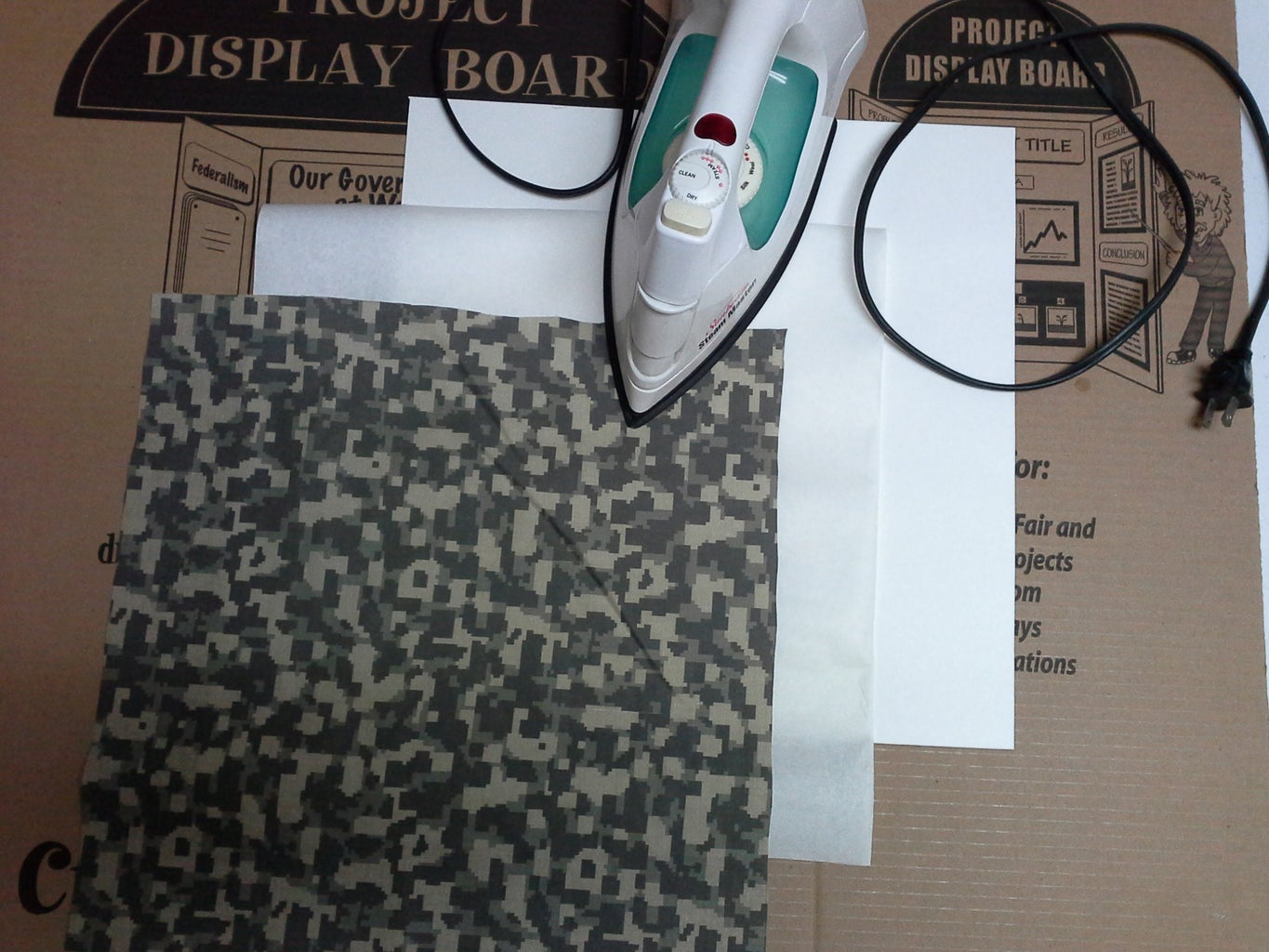 Application of Fabric to Poster Board.