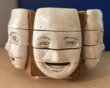 A 'Changing Faces' Sculpture