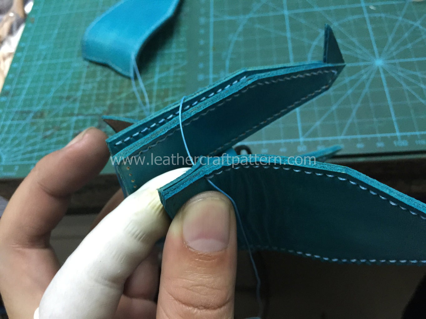 Glue and Sew 2 Pieces of Wings On, Here Please Notice, at First You Sew 2 Pieces of Wing Leather But When It Needs the Belly's Stitching Hole, Sew With Belly Together.
