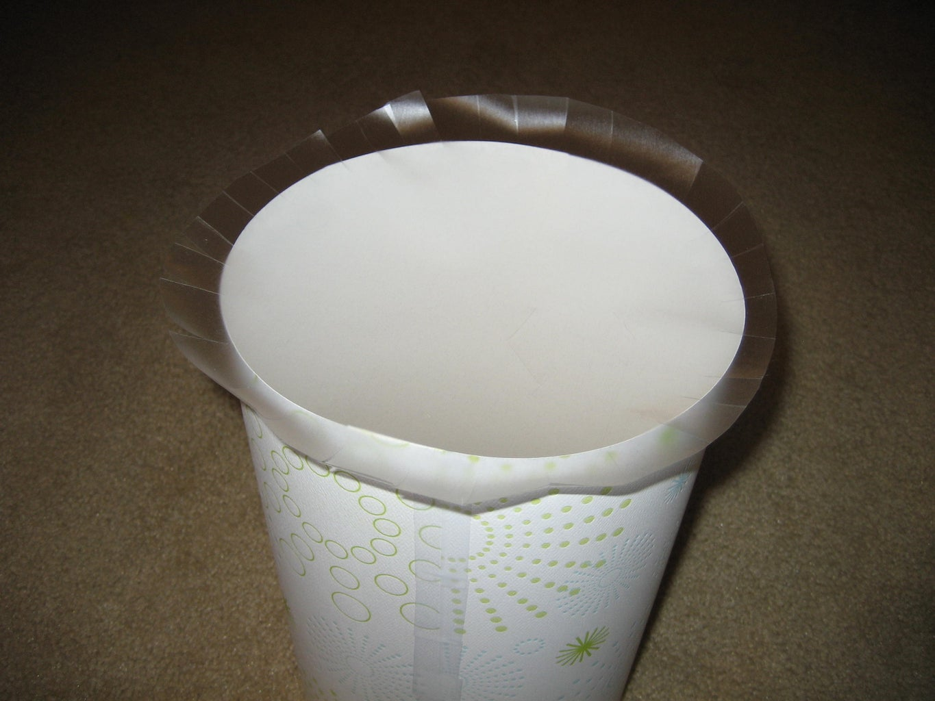 Place the Circle of Contact Paper on Top of the Cylinder, and Gently Fold Down the Pieces of Contact Paper All the Way Around.