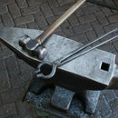 Bolt tongs forged of 2 railroad spikes