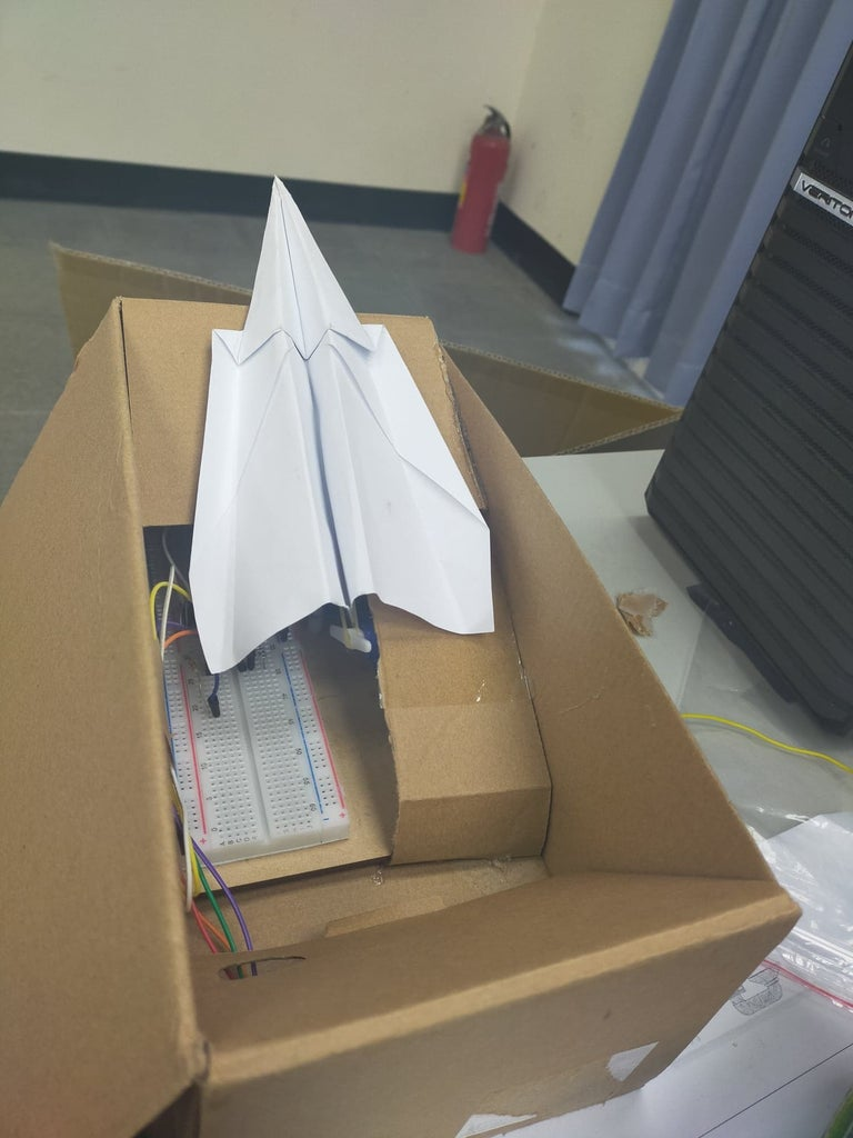 HOW to                                                                                           Make a  Paper Airplane Launcher