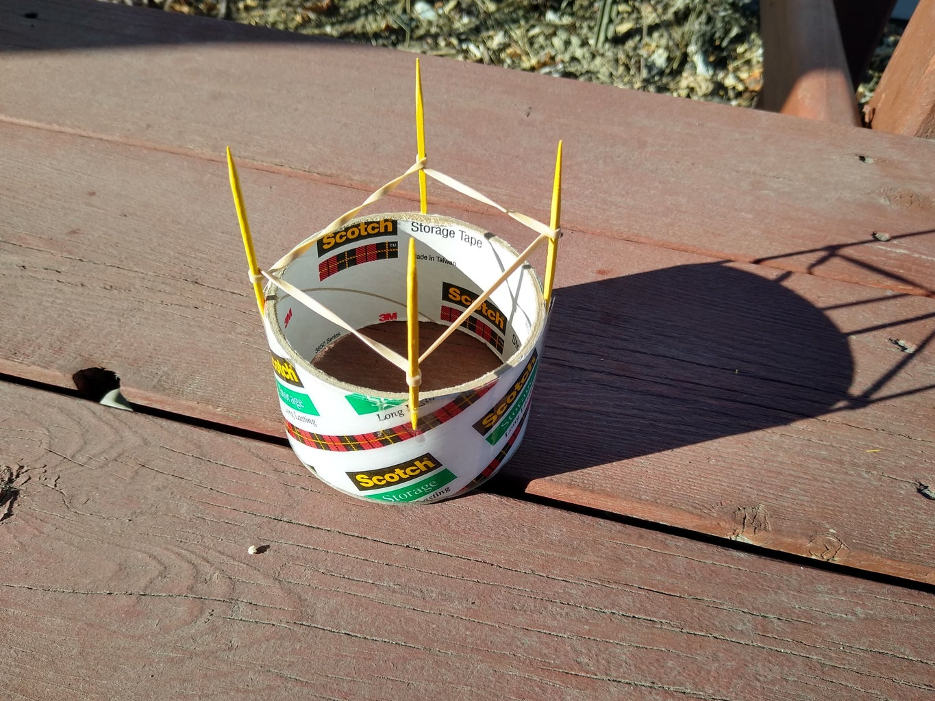 Stretch One Rubber Band Around All Four Posts. Then, Twist Each Corner of the Rubberband and Re-stretch It Around Each Post.