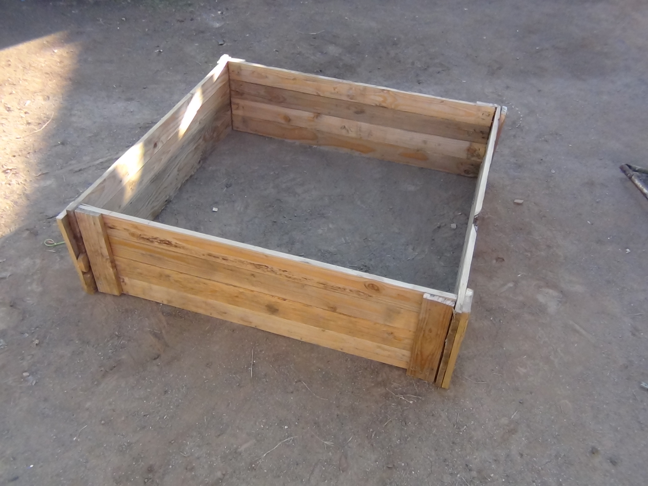 How to make a raised bed garden box from wood pallets.