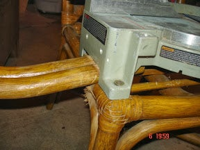 Mounting the Saw to the Chair With the Arms (outrollers) Positioned Under the Saw.