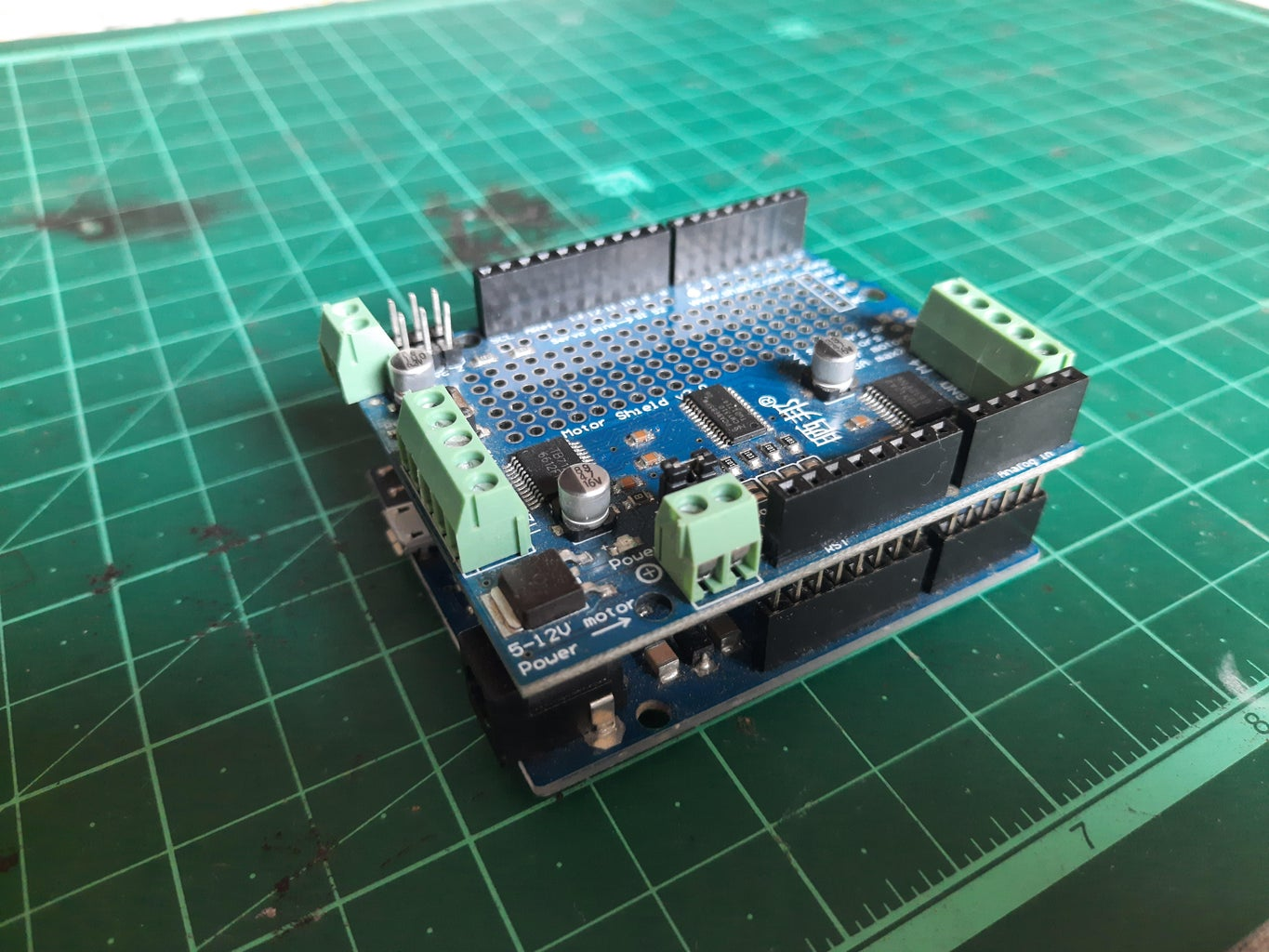Install the Motor Shield on the Arduino Board