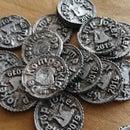 在棉花腻子中铸造的锡币