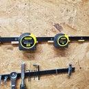 Warning! Tape Measure Rack