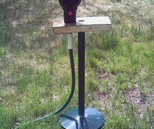 Sprinkler Stand Out of a Torchiere Style Lamp