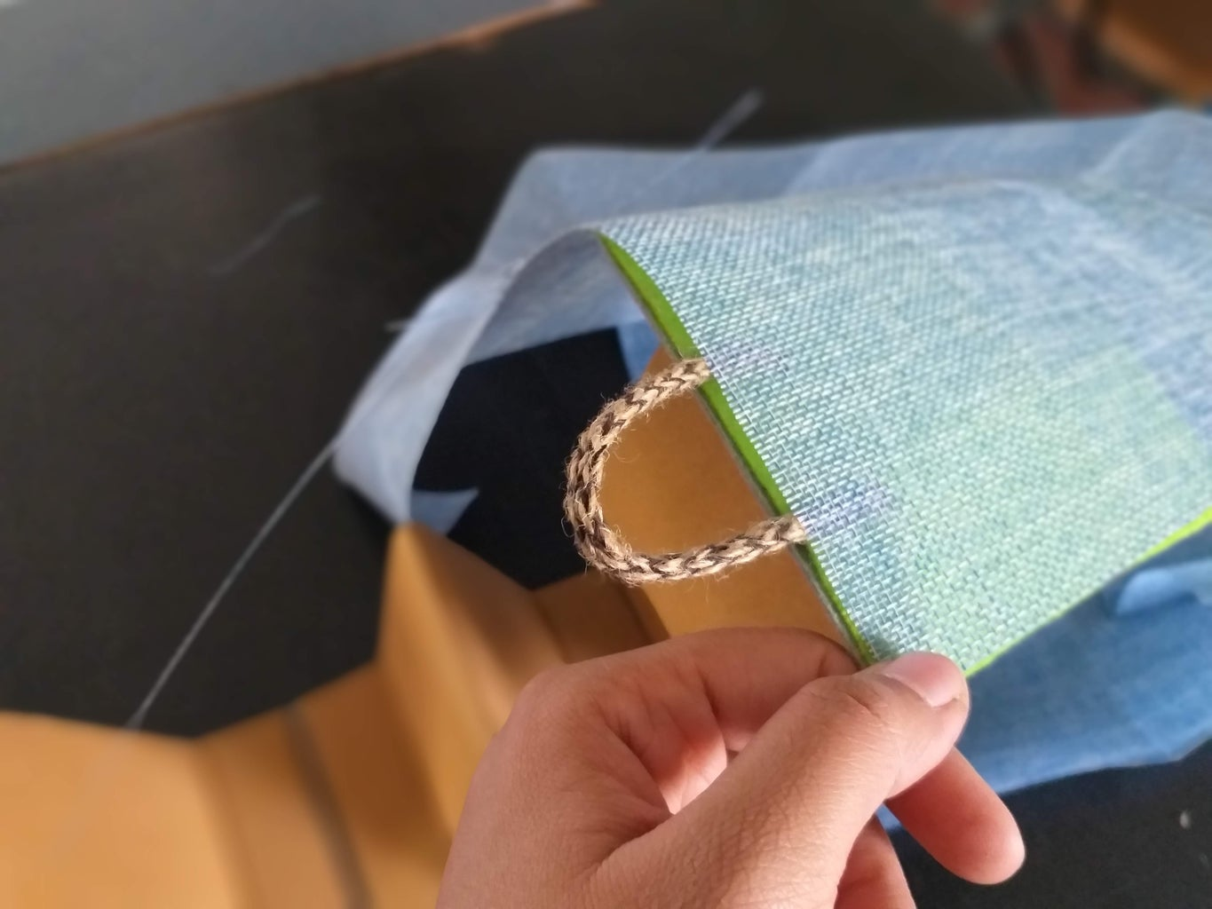 Stick the Rope Piece and Then Stick the Outer Layer of Decorative Fabric.