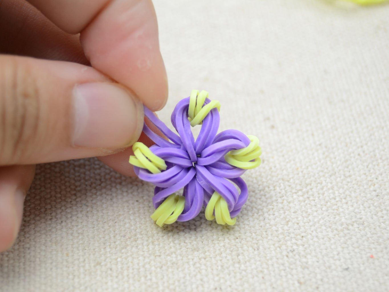 Cross the Two Ends and Tighten It,  to Finish the First Flower;