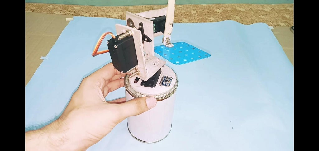 When All the Wires and Components Are Placed Inside a Food Can Then Applied Glue Gun at the Base of Foam Board.