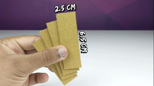 Take 4 Pieces of Foldable Cardboard, 6.5cm * 2.5 Cm, and Cut From the Bottom As Shown. Bend Them to Form a Curve.