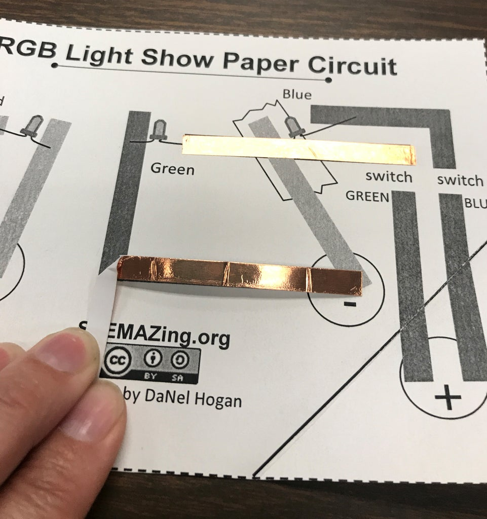 Cutting the Next Piece of Copper Foil Tape With a 90 Degree Turn.