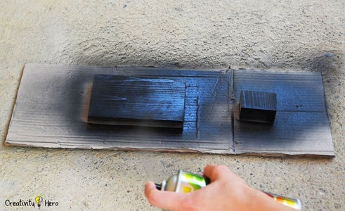 Painting the Wooden Pieces.