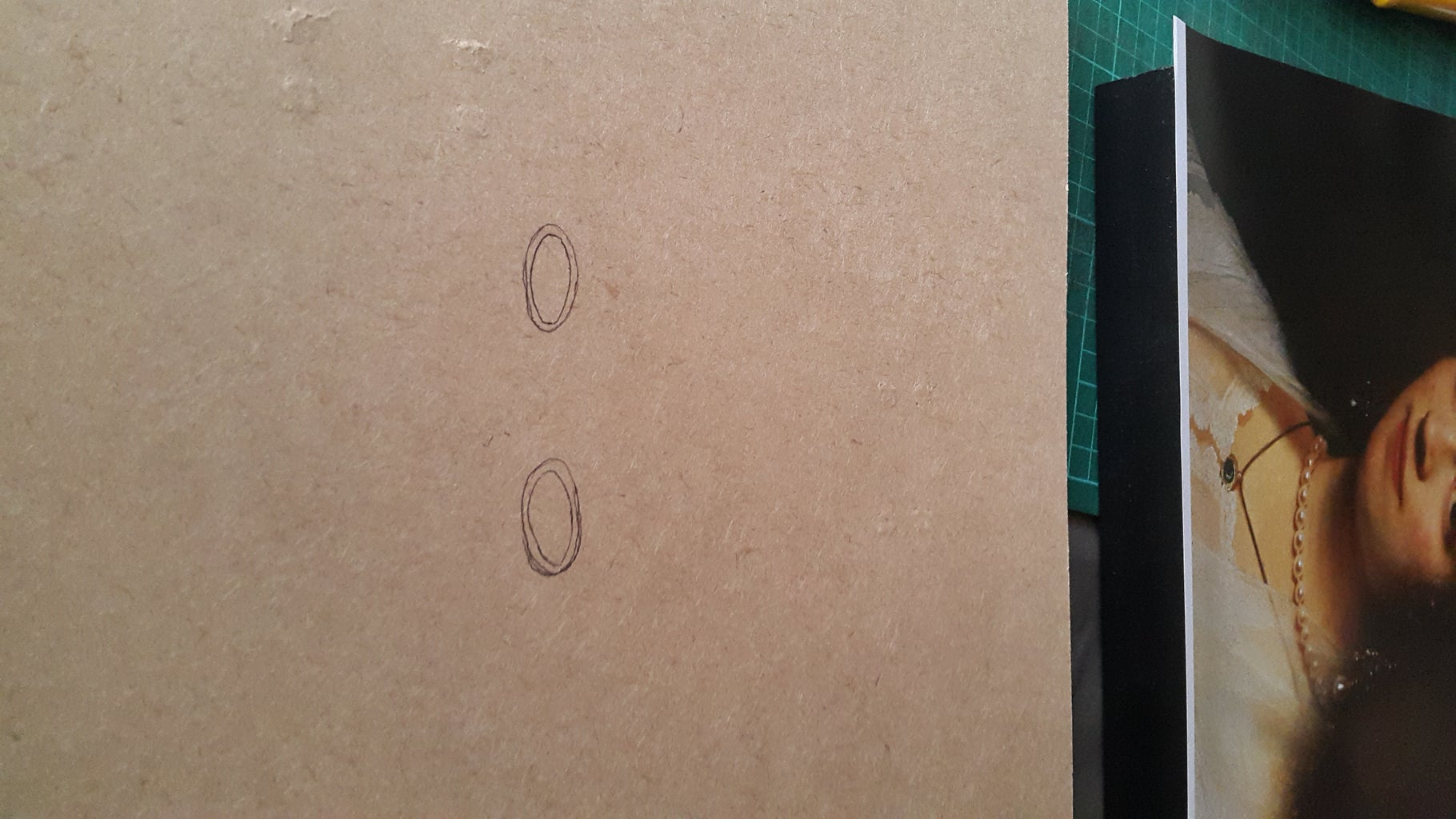 Cut Out the Eyes From the Backing Board