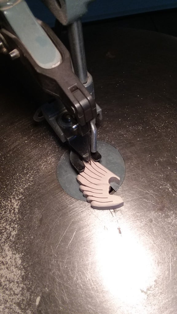 Sand Bottom of Parts to Adjust Thickness, Then Cut Tail Feather Divisions.