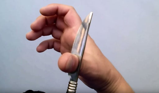 Now, That Has Been Our Plastic Knife Ready,  We Place It on Your Finger.