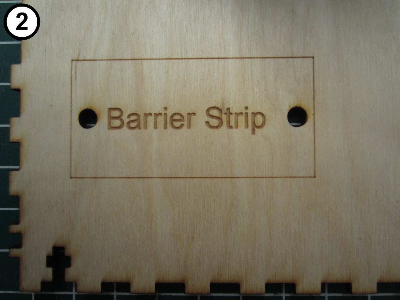 Attach the Barrier Strip to the Bottom Panel