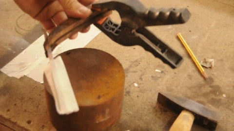 Tighten With a Pliers.