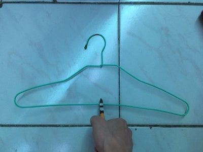 Cut the Lower Part of the Hanger in Half.