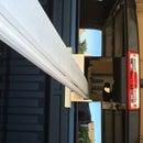 Thru-window long board support for pick-up trucks