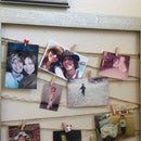 Upcycle! De-Clutter! Old picture frame into a clothesline style collage frame