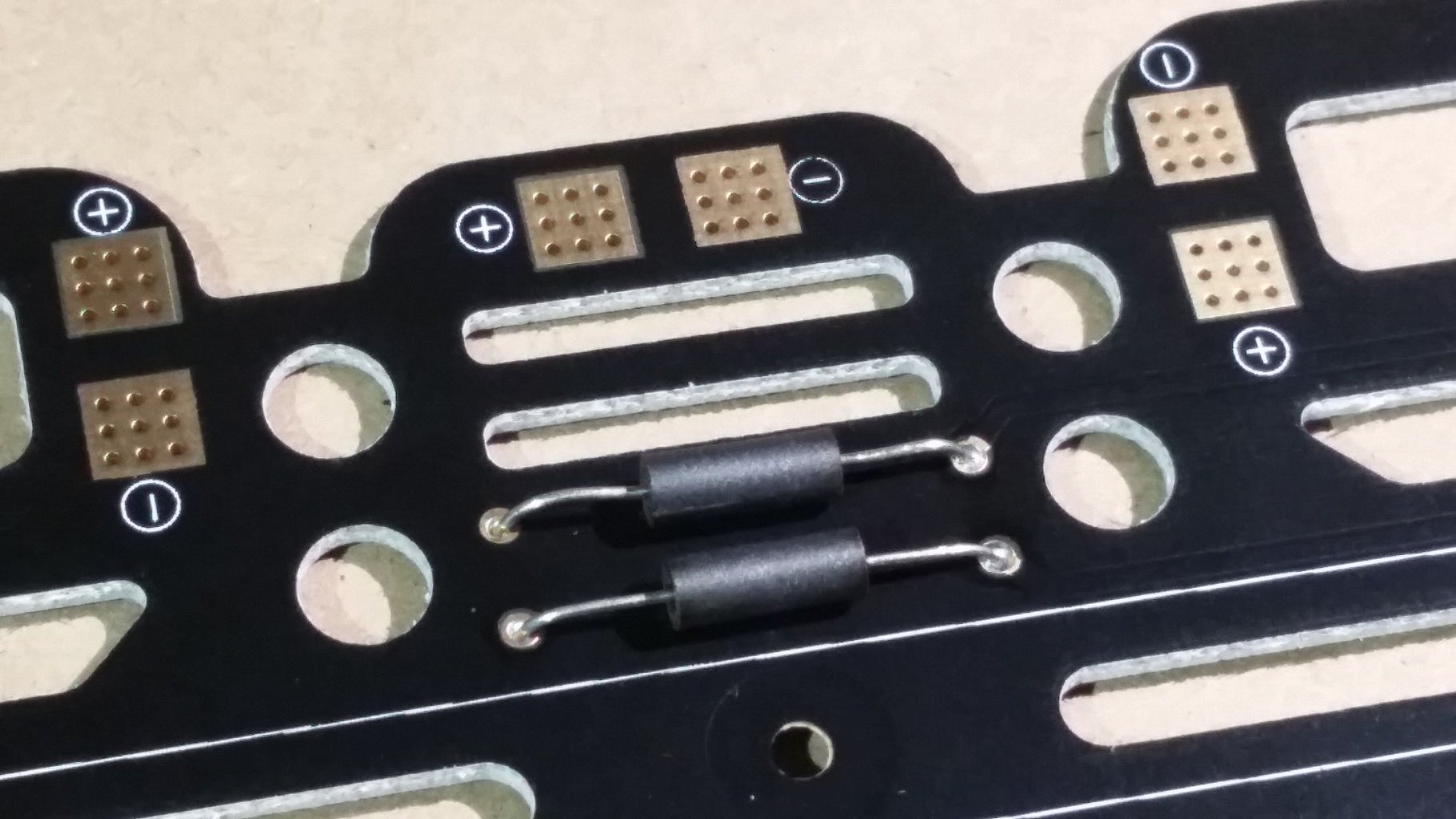 Solder Ferrite Beads to the Power Distribution Board