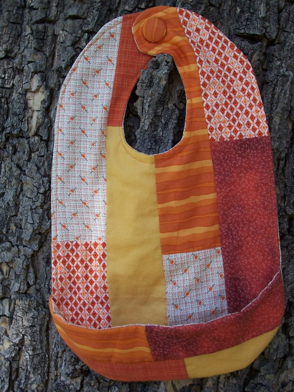 Reversible Quilted Bib With Pocket