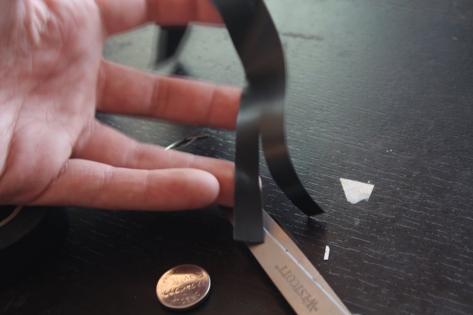 Wrap the Coin Battery W/Electrical Tape