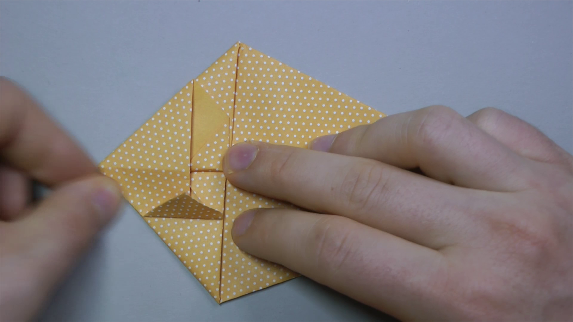 Fold in Top Corners to Center