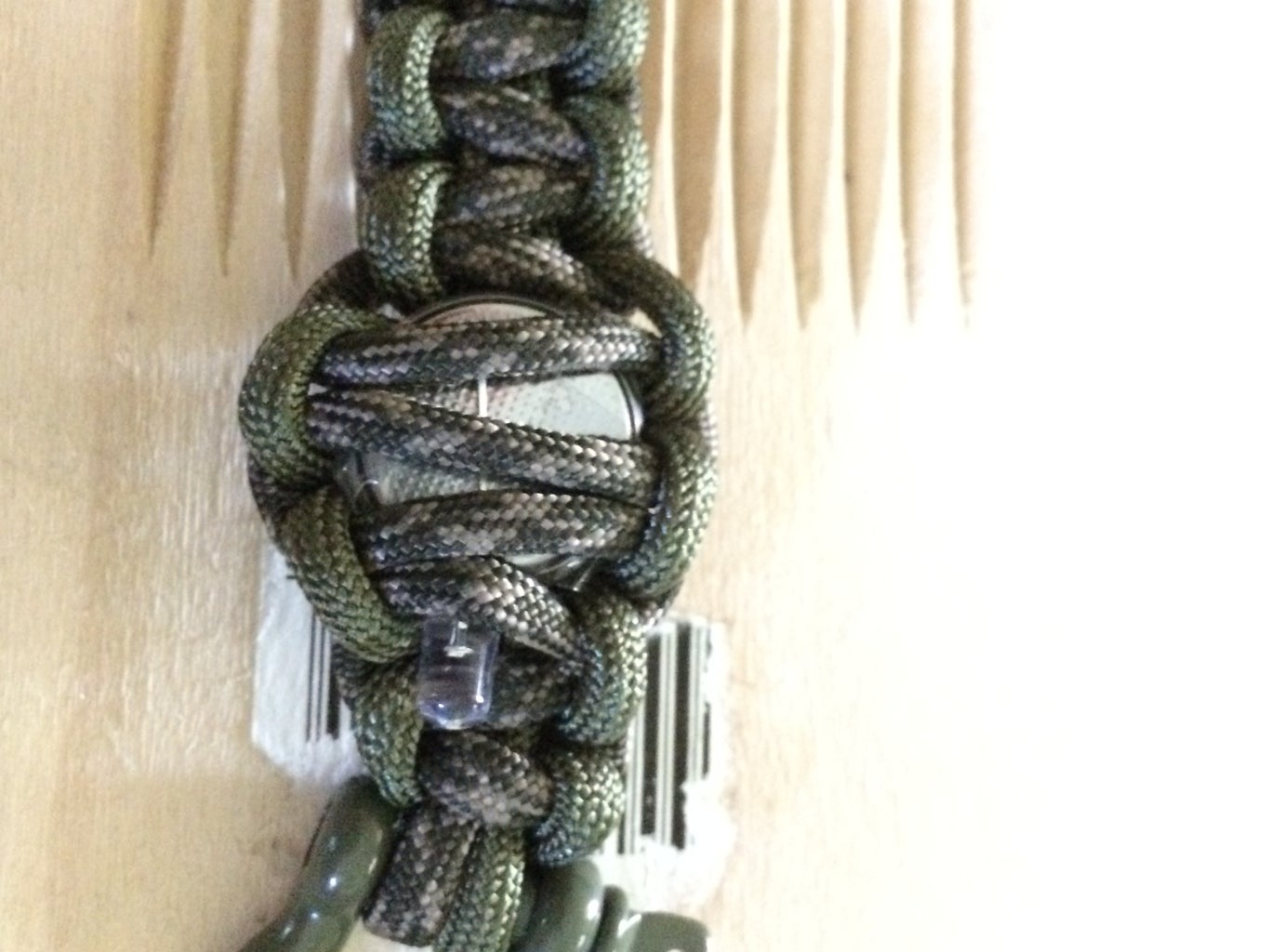 Knotting the Paracord Around the Battery Light