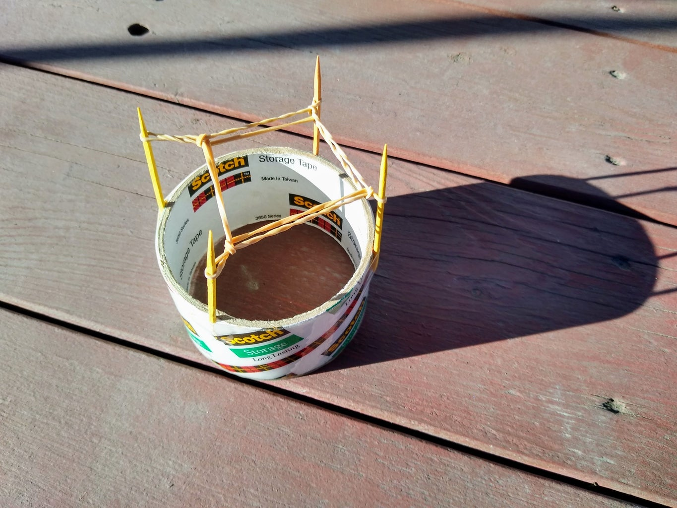Stretch the First Rubber Band Up and Over the Second on Each Post.