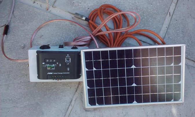 small 12v battery solar power charging rig for a caravan or