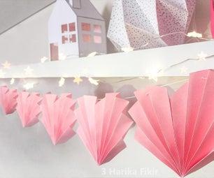 粉红色的心花环与纸