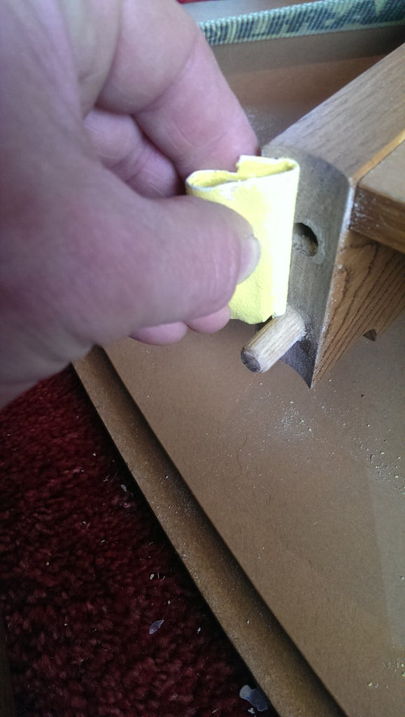Remove All Loose Bits and Sand Off Old Glue Carefully . Wood Glue Works Best on Bare Wood.