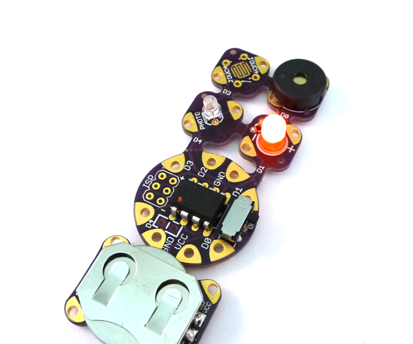 SnapNsew: a Soft-Circuit / Embedded Electronic Project