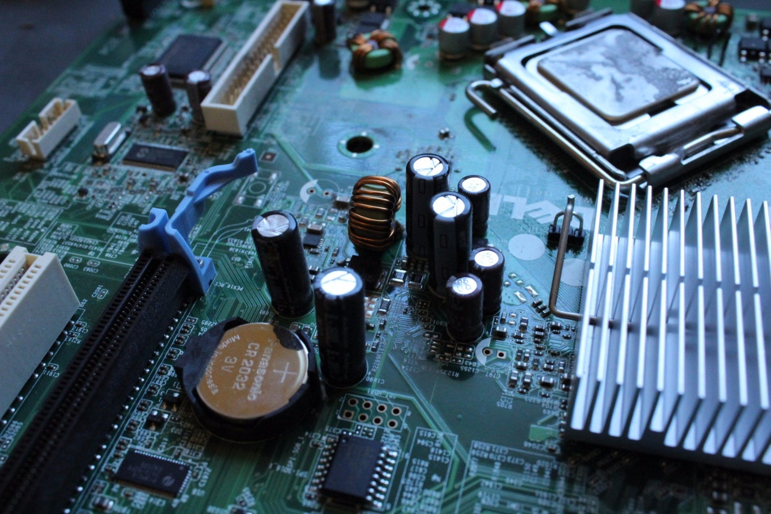 Disassembling Your Motherboard:  Removing Capacitors