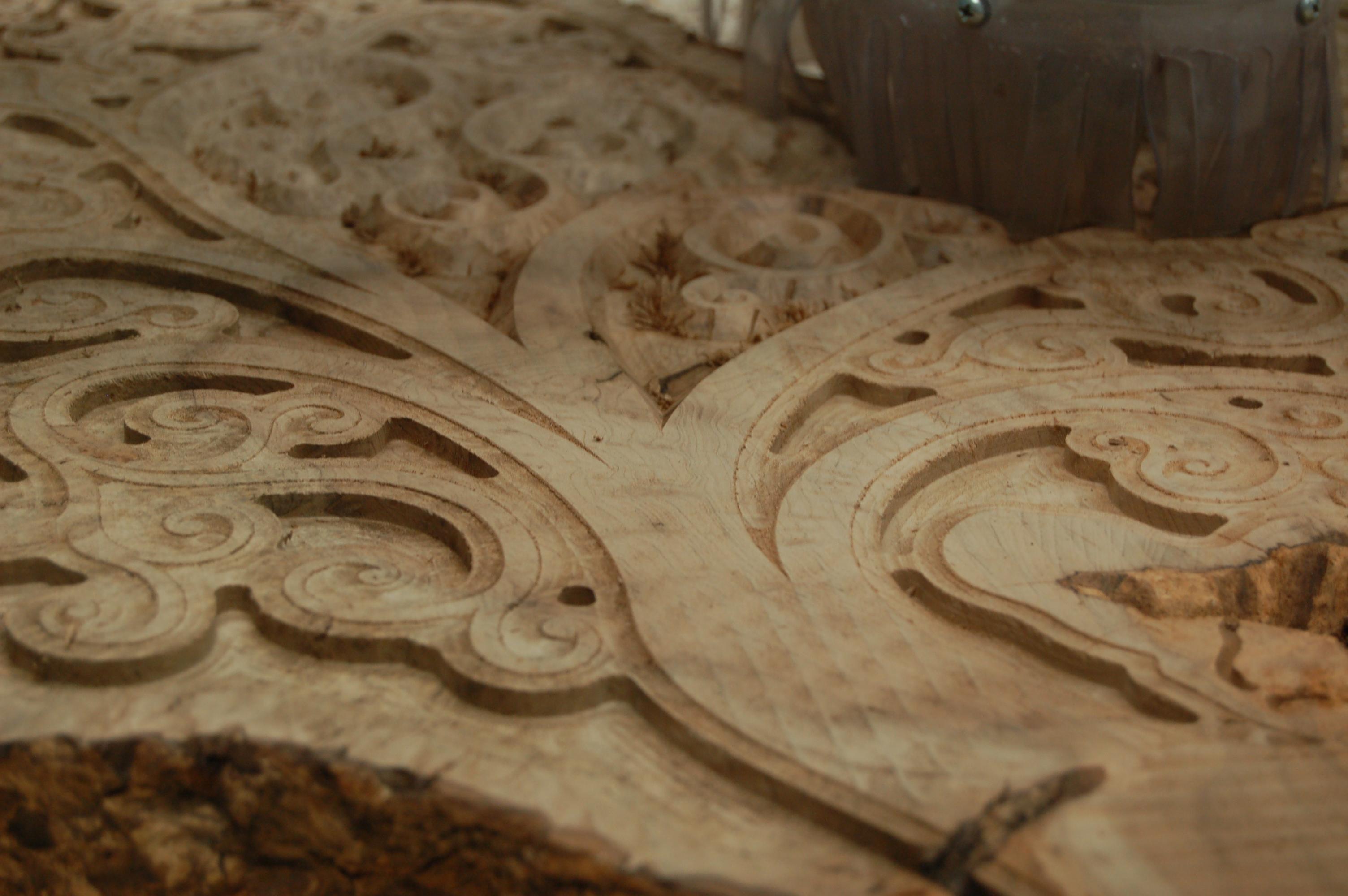 Carving custom designs into irregular shaped wood